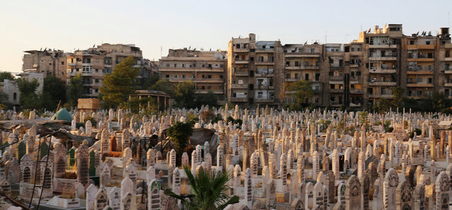 An over-crowded graveyard is pictured in the rebel held al-Shaar neighbourhood of Aleppo, Syria October 6, 2016. (Photo by Abdalrhman Ismail/Reuters)