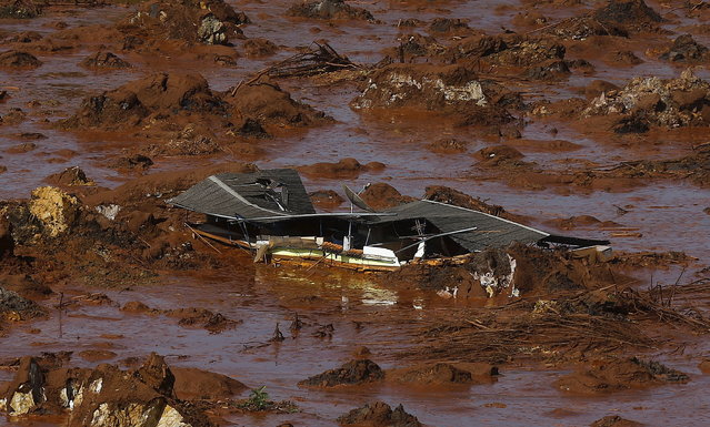 Debris of a house is pictured at Bento Rodrigues district, which was covered with mud after a dam owned by Vale SA and BHP Billiton Ltd burst in Mariana, Brazil, November 6, 2015. A dam holding back waste water from an iron ore mine in Brazil that is owned by Vale and BHP Billiton burst on Thursday, devastating a nearby town with mudslides and leaving officials in the remote region scrambling to assess casualties. (Photo by Ricardo Moraes/Reuters)