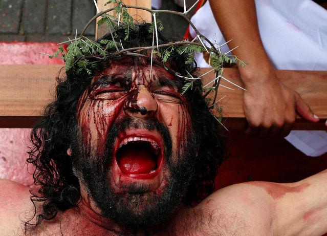 "An actor takes part in a ""Via Crucis"" procession during Holy Week in Yumbo, Colombia March 30, 2018. (Photo by Jaime Saldarriaga/Reuters)"