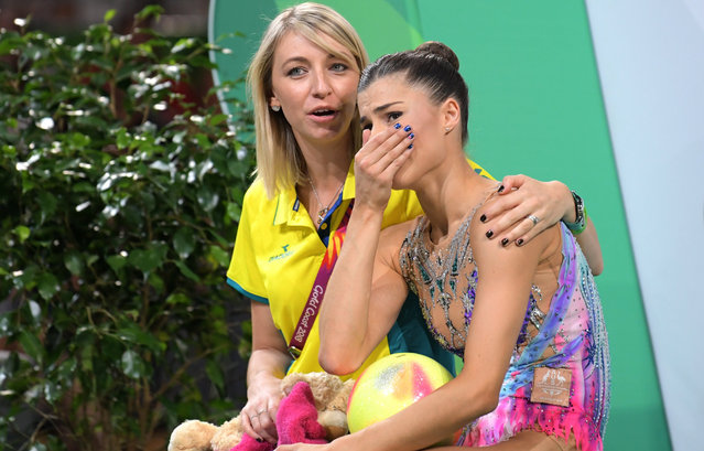 Danielle Prince (R) of Australia reacts after dropping the ball during the Rhythmic Gymnastics Ball final on day nine of competition of the XXI Commonwealth Games, at the Coomera Indoor Sports Centre on the Gold Coast, Queensland, Australia, 13 April 2018. (Photo by Tracey Nearmy/EPA/EFE)