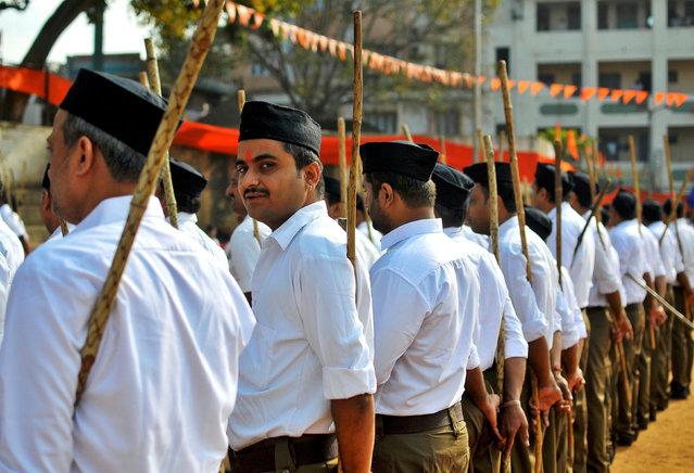 "Volunteers of the Hindu nationalist organisation Rashtriya Swayamsevak Sangh (RSS) prepare to participate in a ""Path-Sanchalan"" or Route March in Bengaluru, India, October 23, 2016. (Photo by Abhishek N. Chinnappa/Reuters)"
