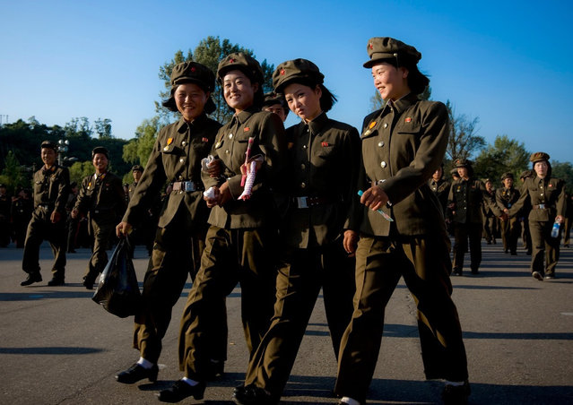 """""""I was surprised to see so many young girls with medals on their uniforms. In fact, they get medals as soon as they have participated to a commemoration or a military parade..."""". (Photo and caption by Eric Lafforgue)"""