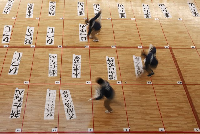 Staff members of a calligraphy contest collect writings of participants at a new year calligraphy contest in Tokyo January 5, 2015. (Photo by Issei Kato/Reuters)