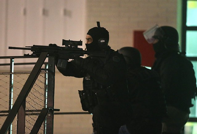 "Police are seen during an operation in the ""Croix-Rouge"" suburb of Reims, northern France early January 8, 2015 following the attack on satirical weekly Charlie Hebdo that left 12 dead in Paris. French police are hunting three men, including two brothers, suspected of carrying out the attack, a source close to the investigation told AFP. (Photo by Francois Nascimbeni/AFP Photo)"
