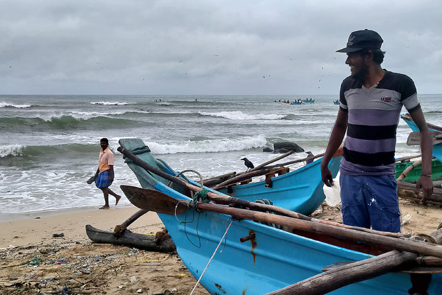 Fishermen prepare to go out in sea in Trincomalee on December 3, 2020. Cyclone Burevi hit Sri Lanka overnight, rattling the island nation but leaving it relatively unscathed on its way to southern India, officials said on December 3. (Photo by AFP Photo/Stringer)