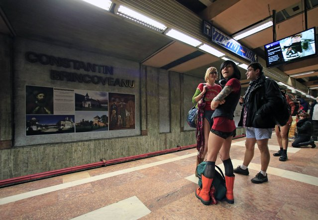 """Passengers without pants wait for the subway train during """"The No Pants Subway Ride"""" in Bucharest January 11, 2015. (Photo by Radu Sigheti/Reuters)"""