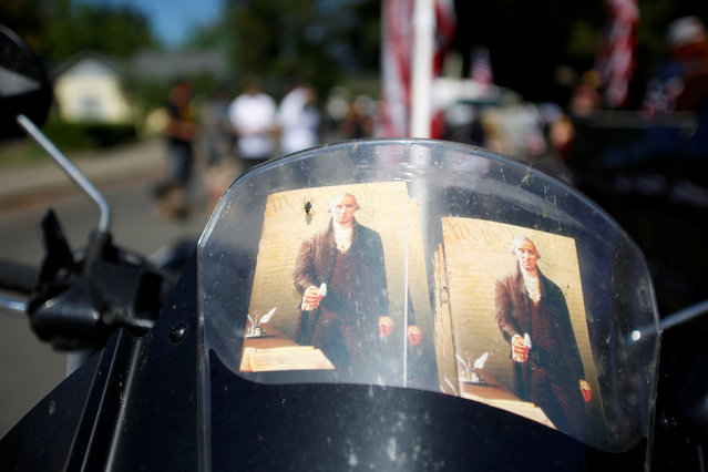 Copies of U.S. Constitution are seen on a motorcycle before the Josephine County Oath Keepers, which later disbanded and became the Liberty Watch of Josephine County, participate in a Memorial Day parade in Grants Pass, Oregon, U.S. May 28, 2016. (Photo by Jim Urquhart/Reuters)