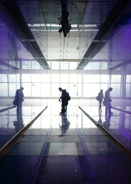 """Reflections"". A powerful space will move us in many ways. This picture captures the moment I first stepped out of the elevator of Sky 100 in Hong Kong, trying to grasp where I was. Location: Sky 100, Hong Kong. (Photo and caption by Ginger Kong/National Geographic Traveler Photo Contest)"