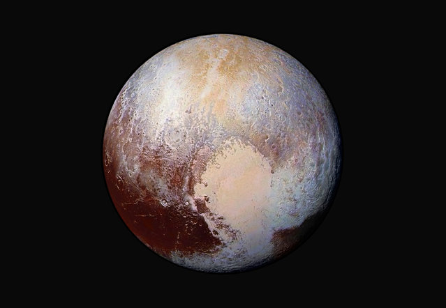 A NASA photo of Pluto made from four images from New Horizons' Long Range Reconnaissance Imager (LORRI) combined with color data from the Ralph instrument in this enhanced color global view released on July 24, 2015. (Photo by Reuters/NASA/JHUAPL/SwRI)