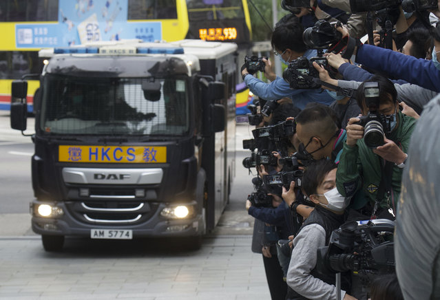 Photographers take pictures as democracy advocate Jimmy Lai arrives at Hong Kong's Court of Final Appeal in Hong Kong Tuesday, February 9, 2021. Prominent democracy advocate and newspaper founder Laiarrived back in court Tuesday, to hear the decision about his bail, whether or not he has to stay behind bars while waiting for trial. (Photo by Vincent Yu/AP Photo)