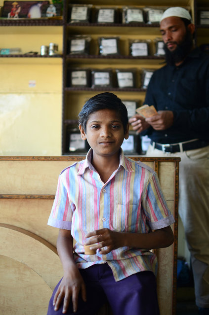 """Now, We Drink Chai"". No trip to India is complete without an aromatic cup of Chai Masala. But for me, this was an experience to remember. After discussing life with the store owner and eventually walking away with a few packets of Jodhpur's finest chai, this young boy offered my a cup of delicious hot chai. He then sat down across from me and said ""Now, we drink chai"". (Photo and caption by Justin Pearson/National Geographic Traveler Photo Contest)"