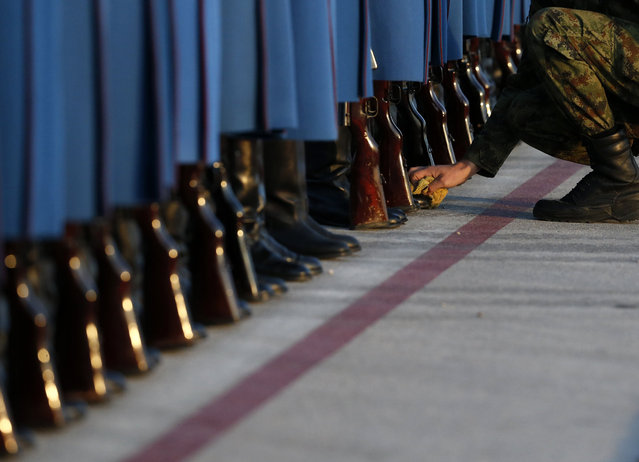 Members of the Serbian Honor guard prepare for the welcoming ceremony for Hungary's Prime Minister Viktor Orban, at the Constantine the Great Airport, in the town of Nis, Serbia, Sunday, November 20, 2016. (Photo by Darko Vojinovic/AP Photo)