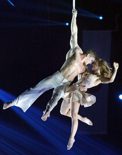 Canadian artists Catherine Audy and Alexis Trudel, known as the Duo Catalexi, perform on the stage of the Phenix circus in Paris, Saturday January 31, 2015, as part of  Tomorrow's Circus World Festival. (Photo by Remy de la Mauviniere/AP Photo)