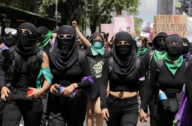 Women take part in a protest in support of Victoria Salazar, a Salvadoran woman who died after a Mexican female police officer was seen in a video kneeling on her back, in Mexico City, Mexico on April 2, 2021. (Photo by Raquel Cunha/Reuters)