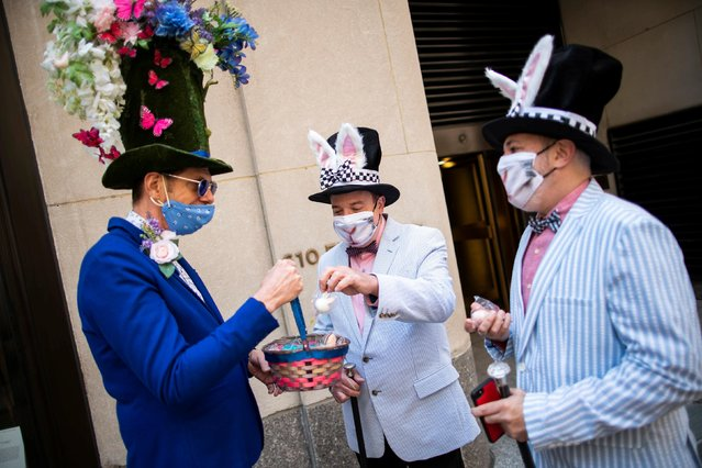 People wearing costumes attend the annual Easter Parade and Bonnet Festival on Fifth Avenue, amid the coronavirus disease (COVID-19) pandemic, in New York City, U.S., April 4, 2021. (Photo by Eduardo Munoz/Reuters)