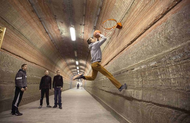 Boys play basketball in the facilities of Belarus' Republican Clinic of Speleotherapy within a salt mine, as part of their treatment, near the town of Soligorsk, south of Minsk, February 19, 2015. According to the state clinic, more than 7,000 children and adults seek medical treatment for respiratory illness each year in the subsurface chambers of its facilities, located 420 metres underground between layers of potassium and stone salts in an operational salt mine. (Photo by Vasily Fedosenko/Reuters)