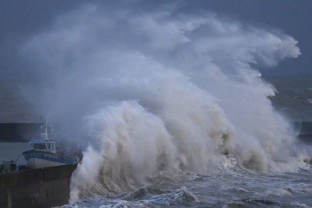 A high wave crashes on the protecting wall at the fishing harbour in Pornic, France as stormy weather with high winds hits the French Atlanitic coast January 11, 2016. (Photo by Stephane Mahe/Reuters)