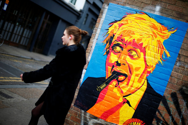 A woman walks past a caricature of Britain's Foreign Secretary Boris Johnson in east London, Britain November 18, 2016. (Photo by Andrew Winning/Reuters)