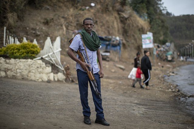 Amhara militia member Nega Wagaw poses for a photograph on a street in Gondar, in the Amhara region of Ethiopia Sunday, May 2, 2021. (Photo by Ben Curtis/AP Photo)