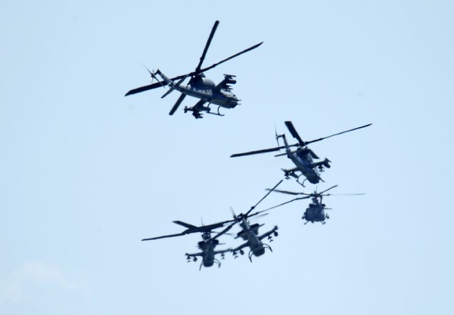 U.S. military helicopters fly as a group over Camp Pendleton as the USS Makin Island Amphibious Ready Group and 11th Marine Expeditionary Unit returns after a seven month deployment to Camp Pendlaton, California February 23, 2015. (Photo by Mike Blake/Reuters)