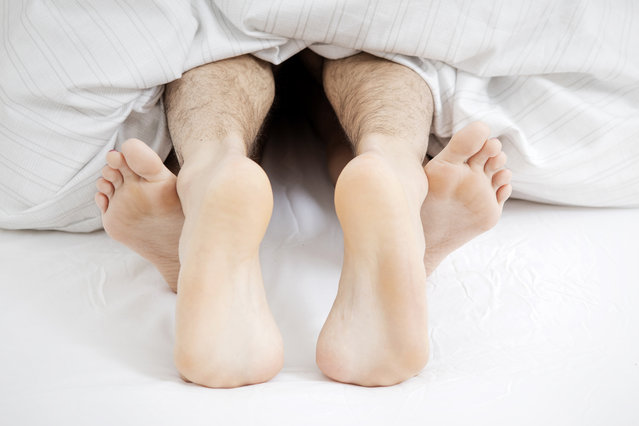 Feet of couple having sеx in bed. (Photo by Getty Images/Westend61)