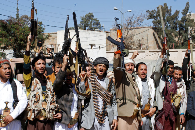 Armed tribesmen loyal to the Houthi movement hold up their weapons during a rally held to mobilize fighters for battles against government forces, in Sanaa, Yemen December 1, 2016. (Photo by Mohamed al-Sayaghi/Reuters)