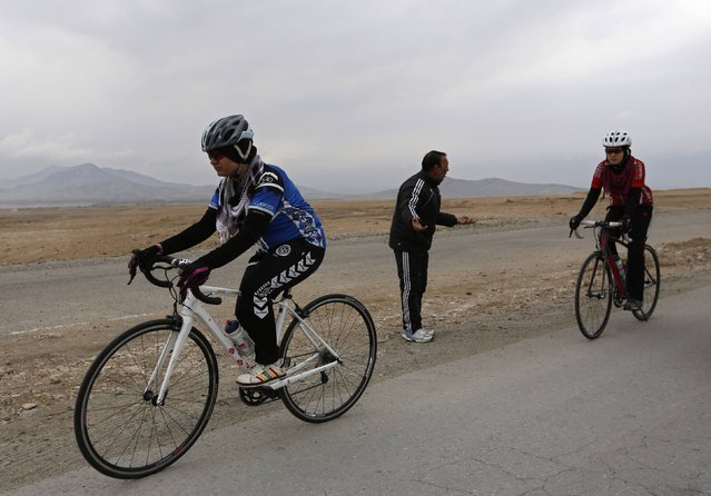 Frozan Rasooli (L) and Masooma Alizada (R), members of Afghanistan's Women's National Cycling Team train on the outskirts of Kabul February 20, 2015. (Photo by Mohammad Ismail/Reuters)