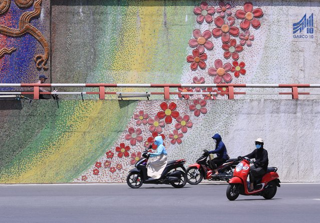 People ride motorcycles in Hanoi, Vietnam Monday, May 31, 2021. (Photo by Hau Dinh/AP Photo)