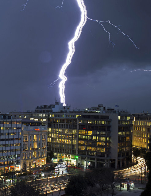 Lightning strikes over buildings at central Syntagma square during heavy rainfall in Athens January 26, 2015. (Photo by Marko Djurica/Reuters)