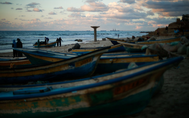 Palestinian fishermen stand among boats at the beach of northern Gaza Strip December 17, 2016. (Photo by Suhaib Salem/Reuters)