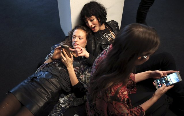 Models talk in the backstage of Etro Autumn/Winter 2016 women's collection during Milan Fashion Week, Italy, February 26, 2016. (Photo by Stefano Rellandini/Reuters)