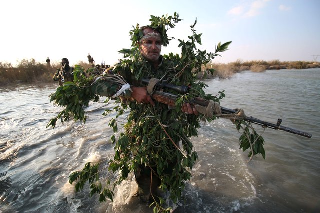 A member of the Saraya al-Salam (Peace Brigades), a group formed by Iraqi Shiite Muslim cleric Moqtada al-Sadr, takes part in a military training session in the town of al-Zubair, near the southern port city of Basra, on February 29, 2016. (Photo by Haidar Mohammed Ali/AFP Photo)