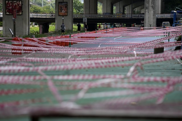 A public sports facility area is taped off for the social distancing measures and precaution against the coronavirus in Seoul, South Korea, Thursday, August 12, 2021. (Photo by Lee Jin-man/AP Photo)