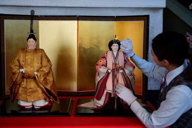 Dolls representing the next Japanese emperor Naruhito (L) and his wife Masako are displayed at Kyugetsu store in Tokyo, Japan on February 22, 2019. (Photo by Martin Bureau/AFP Photo)