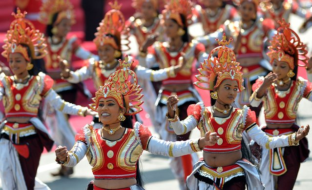 Sri Lankan dancers participate in a parade during the country's 66th Independence Day celebrations in the central town of Kegalle, about 40 kms from the capital Colombo on February 4, 2014. (Photo by Ishara S. Kodikara/AFP Photo)