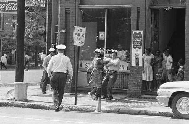 An unidentified Black woman struggles with a policeman after she failed to move on during Black protest marches, May 7, 1963 in Birmingham, Ala. (Photo by AP Photo)