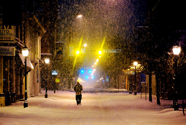 A lone pedestrian walks the streets of Hagerstown, Maryland.  (Photo by Kevin G. Gilbert/The Herald-Mail)