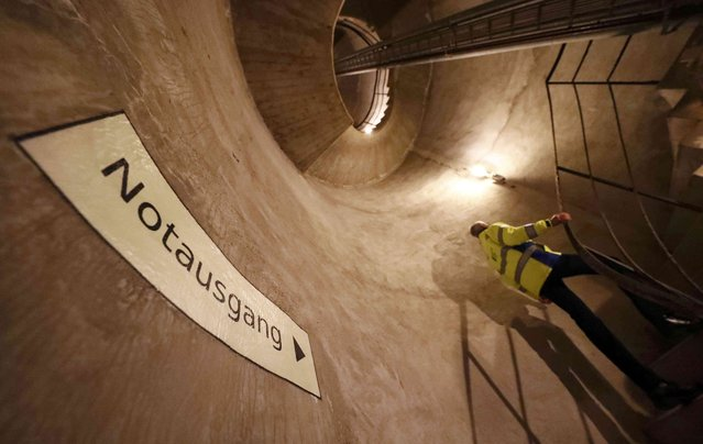 A 20 metre high spiral staircase in a tower used as an emergency exit, is seen inside a Federal Reserve bank (Bundesbank) bunker, prior to the bunker's official opening to the public in Cochem, Germany, March 18, 2016. (Photo by Kai Pfaffenbach/Reuters)
