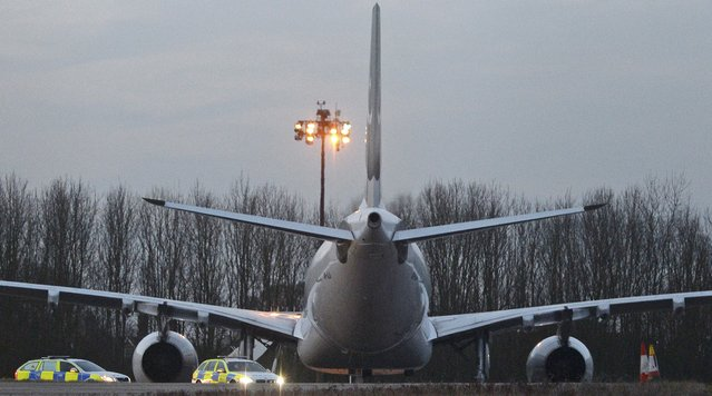 Police cars are parked next to a Pakistan International Airlines aircraft that was intercepted and escorted by fighter jets to Stansted airport northeast of London because of a disruptive passenger, Britain's police said, February 7, 2017. (Photo by Alan Walter/Reuters)