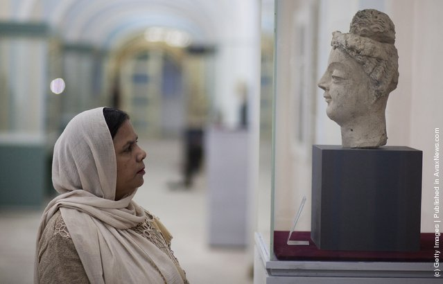 An ancient sculptures, pottery and bowls is displayed in the Kabul Museum August 4, 2011 in Kabul, Afghanistan