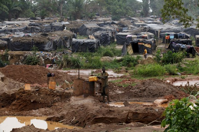 A camp for gold prospectors is seen around a gold mine near the village of Gamina in western Ivory Coast, March 16, 2015. (Photo by Luc Gnago/Reuters)