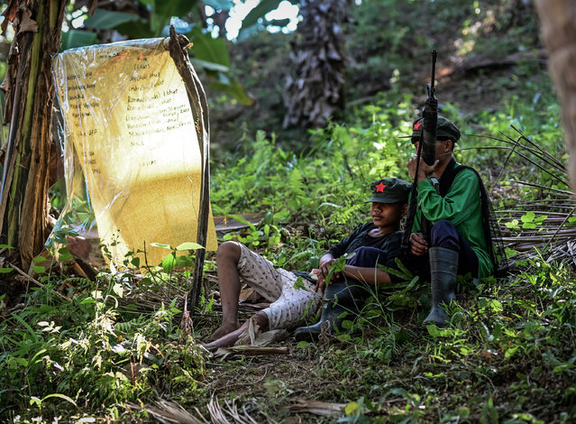 Fighters of the New People's Army-Melito Glor Command (NPA-MGC) rest on the ground at an undisclosed location in the mountains of Sierra Madre, Philippines, 31 March 2019. (Photo by Alecs Ongcal/EPA/EFE)