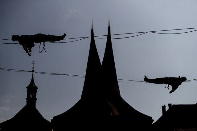 People balance on a slackline over the Emmaus Monastery in Prague, Czech Republic, 01 April 2019. This event was part of campaign supporting mental health. (Photo by Martin Divisek/EPA/EFE)