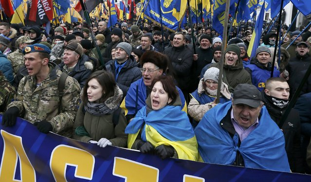 Activists of nationalist groups and their supporters take part in the so-called March of Dignity, marking the third anniversary of the 2014 Ukrainian pro-European Union (EU) mass protests, in Kiev, Ukraine, February 22, 2017. (Photo by Valentyn Ogirenko/Reuters)