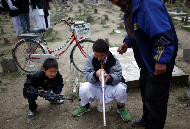 A boy shoots targets as he plays during the Afghan New Year (Newroz) celebration in Kabul March 21, 2014. (Photo by Ahmad Masood/Reuters)