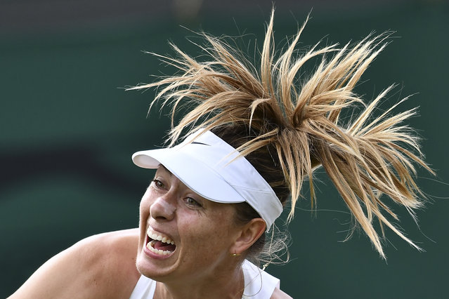 Russia's Maria Sharapova serves against France's Pauline Parmentier during their women's singles first round match on the second day of the 2019 Wimbledon Championships at The All England Lawn Tennis Club in Wimbledon, southwest London, on July 2, 2019. (Photo by Ben Stansall/AFP Photo)