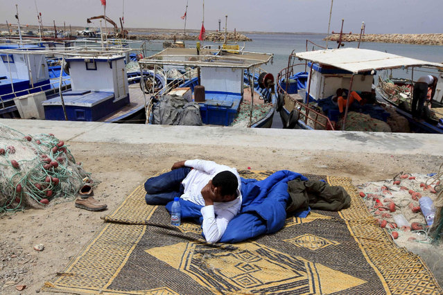 A migrant rests at outside a temporary detention centre after being rescued by Tunisian authorities in Ben Guerdane, Tunisia, June 16, 2015. The migrants belong to a group of more than 350 illegal migrants who were rescued by Tunisia's navy on June 10. REUTERS/Anis Mili