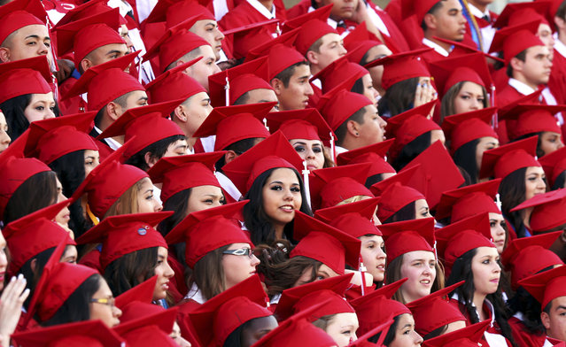 In this June 7, 2014, file photo, Odessa High School graduates pose for a group portrait prior to the start of the commencement ceremony in Odessa, Texas. It's not a promising picture for the nation's high school seniors, they are slipping in math, not making strides in reading and only about one-third are prepared for the academic challenges of entry-level college courses. Scores released April 27, 2016, from the so-called Nation's Report Card show one-quarter of 12th graders taking the test performed proficiently or better in math. Only 37 percent of the students were proficient or above in reading. (Photo by Edyta Blaszczyk/Odessa American via AP Photo)
