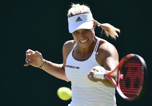 Angelique Kerber of Germany plays a shot during her match against Carina Witthoeft of Germany at the Wimbledon Tennis Championships in London, June 30, 2015. (Photo by Toby Melville/Reuters)
