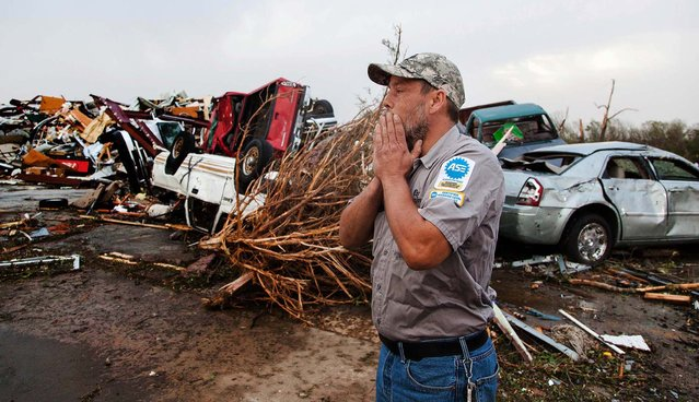 John Smith reacts after seeing what's left of his auto repair shop in Mayflower, Arkansas on Monday. (Photo by Karen E. Segrave/Associated Press)